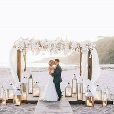 Beach weddings create such a romantic ambiance! Loving the added romance the lanterns add too! Photographer @brandonkiddphoto