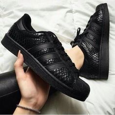 Black snakeskin Adidas Superstar sneakers