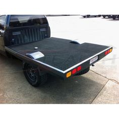 Low Lying Mild Steel Tray 2pc Colour Match to Cab, with marine grade carpet, wheel tubs, recessed number plate and tail-lights.