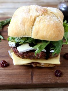 These cherry rosemary burgers topped with slices of Wisconsin brie and havarti, grilled onions, arugula and a balsamic glaze are ready to elevate any barbecue or tailgate.