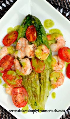 Grilled Romaine Hearts, Tomatoes, & Shrimp with Basil Vinaigrette makes an easy, healthy meal on the grill! serenabakessimplyfromscratch.com