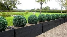Our awesome artificial topiary will have your garden, outdoor areas or your living room looking a million bucks, all without having to spend a cent on maintenance. These dense, lifelike boxwood leaf hedge balls are perfect for indoor or outdoor use and c Boxwood Hedge, Boxwood Topiary, Topiary Trees, Topiary Plants, Planter Boxes, Planters, Planter Ideas, Artificial Topiary, Outdoor Wedding Decorations