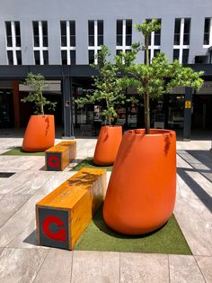 Bold tangerine Oblique Pebble Pots (for which we have three sizes) provide potted landscaping and colour to the entrance of this boutique shopping center, emphasizing the pigment used in the logo #igneous_concrete #polyconcrete #pottedlandscaping #pottedplants #courtyarddesign #tangerine Trough Planters, Planter Pots, Courtyard Design, Higher Design, Outdoor Landscaping, Shopping Center, Potted Plants, Entrance, Concrete