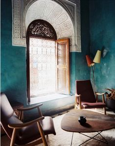 Teal wall in Moroccan hotel - makes the decorative doorway look almost lacy