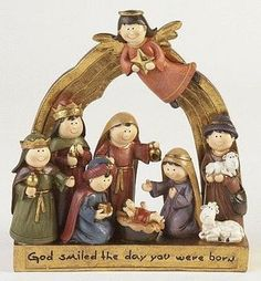 "Children Nativity Scene on Gold Base. Size 8"" height. Saying: God smiled the day you were born."
