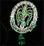 The Ladies of North Wales brooch. The diamond-set brooch was a wedding gift from the Ladies of North Wales to Princess Alexandra of Denmark. The Prince of Wales feathers is encircled by 18 diamonds and 36 emeralds with a hanging emerald pendant.