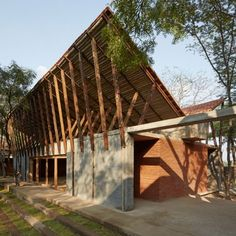 Sameep Padora builds Buddhist Learning Centre in an Indian forest grove.