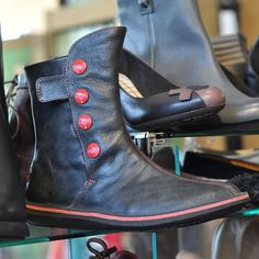 Perfect for winter: Camper women's boot with red buttons $210. || The Children's Hour Bookstore & Boutique || Clothing  Gifts  Toys  Shoes || 898 South 900 East || Salt Lake City Utah || 801.359.4150 || childrenshourbookstore.com