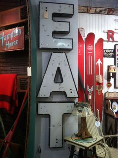 LOVE this E A T sign here at #HPmkt.  Great fun wall decor for wonderful industrial loft.