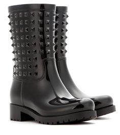 Valentino - Rockstud rubber boots - Dotted with the house's signature pyramid studs, Valentino's rubber rain boots are a chic choice for rainy days. In all-over black, they'll pair with everything from denim to leather to feminine dresses. seen @ www.mytheresa.com