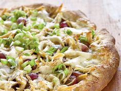 Grapes make an ideal salad topping, but what about on pizza...? This surprising addition is a sweet contrast to the tangy Romano cheese,...