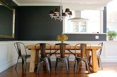 kitchen window into dining room; dark walls in dining room