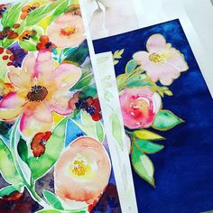 Original floral paintings waiting in a row ha! 😄 to get their #cellophane on them 🌸💜 #packaging 🍍🍍🍍  .  .  .  #watercolorist #painting #paintings #floral #florals #watercolorflowers #artistsofig #art🎨 #artistlife #mik #peony #navyblue #onmydesk #studioscenes #before a #craftfair #creativemess #etsyseller #etsyfinds #originals #goodvibesonly