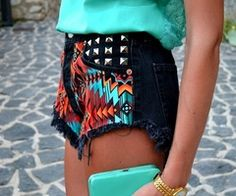 Studded black shorts with a dash of color