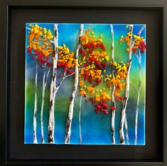 Bring nature inside with this amazing handmade fused glass panel. This beautiful piece of art is measures 12x12 inches framed. It took almost 80hours of kiln time to make. Each layer is made using only glass the final layer adds the most depth with three dimensional trees that give