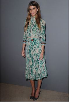 To an event in Paris, Bianca Brandolini wears a Gucci Spring Summer 2016 snake printed silk blouse with embroidered sleeve detail and a matching skirt by Alessandro Michele.