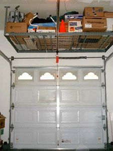 Ceiling Storage Above The Garage Door.. Becoming Very Popular   At Least