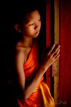 Young Buddhist monk in Thailand - Photo by Gavin Gough