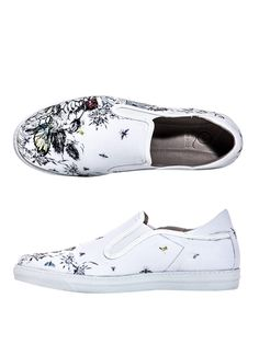 White slip-on canvas trainers with a floral illustration and elasticated  side panels. McQ 5b923901f
