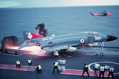 Great angle to illustrate some alterations to the Phantom as licence built in Britain for the Royal Navy. By the late HMS Ark Royal IV was a fairly old design, dwarfed by America's. Military Jets, Military Aircraft, Fighter Aircraft, Fighter Jets, Airplane Fighter, Hms Ark Royal, Photo Avion, F4 Phantom, British Armed Forces