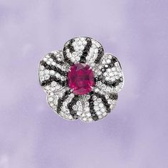 MARGHERITA BURGENER ring of  rubelite tourmaline, black and white diamonds.