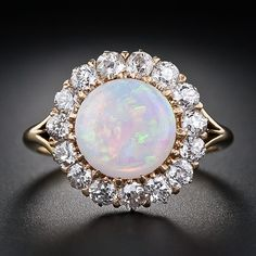 Antique Opal and Diamond Halo Ring