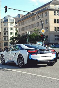 BMW i8 The BMW i8, first introduced as the BMW Concept Vision Efficient Dynamics, is a plug-in hybrid sports car developed by BMW. The 2015 model yearBMW i8 has a 7.1 kWh lithium-ion battery pack that delivers an all-electric range of 37 km (23 mi) under the New European Driving Cycle (NEDC).[5] The production version has a fuel efficiency of 2.1 L/100 km (134.5 mpg-imp; 112.0 mpg-US) under the NEDC test with carbon emissions of 49 g/km.