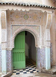 Green door with tiled doorway. Morocco