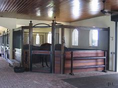 I like the idea of having a bigger corner stall positioned like this for a foaling stall/stallion stall/just for that special horse :) Built by Lucas Equine