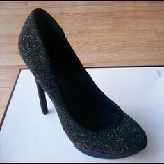 Like new Fontanne Platforms by Brian Atwood- 10 I have a like new pair of glittery black, gold, red, and blue Fontanne heels by B Brian Atwood in a size 10. The shoe had a 5.5 in heel with a 1.5 inch platform. I wore these shoes 1x indoors. They are pristine. I am selling because they are a bit narrow for my wide feet. Guaranteed authentic like all of my other items. Please make any offers using the make an offer button. Sorry, these do not come with a box. B Brian Atwood Shoes