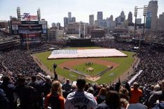 Grounds crew holds a giant American flag as part of the opening ceremonies during Opening Day for the Detroit Tigers on Monday March 31, 2014 at Comerica Park.