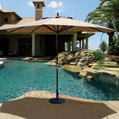 This 8' x 11' Oval Wood Premium Market Umbrella features 100% solution dyed Sunbrella canopy fabric and Quad Pulley Rope system provides ease of use. Enjoy it for $459.00 only.  Product ID : GAL-279 #PatioUmbrella