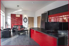 Red and black reception area and waiting
