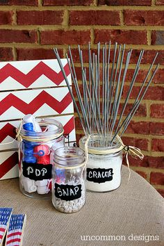 Set up a 4th of July fun station at your backyard party—cover a table with burlap and set out bubbles, sparklers, and poppers.