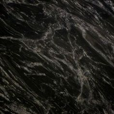 SILVER PARADISO. Swirls and waves of white grey on deep black. Exotic granite color available at Knoxville's Stone Interiors. Showroom located at 3900 Middlebrook Pike, Knoxville, TN. www.knoxstoneinteriors.com. FREE Estimates available, call 865-971-5800.