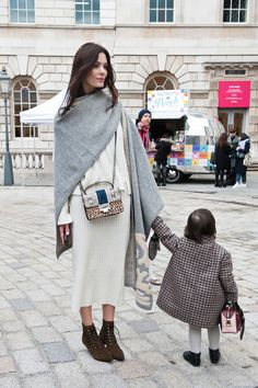 Street Style From London Fashion Week Fall 2015 - cream knit sweatshirt + matching midi skirt worn with a grey oversized scarf + lace-up leopard ankle boots and a mixed animal print crossbody bag—small child may or may not qualify as an accessory! | StyleCaster
