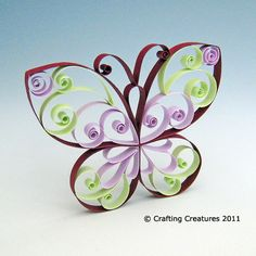 Butterfly Quilling Pattern / Tutorial. via http://craftingcreatures.wordpress.com/2011/08/19/butterfly-quilling-pattern-tuturial/