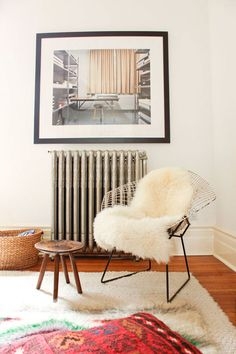 i love the harry bertoia chair paired with the fluffy blanket, good juxtaposition with an industrial piece
