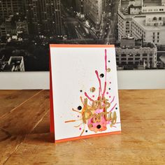 """Let's Sparkle Card. Cardstock: PaperProducts (white), Folia (tangerine, gold); watercolours: Schmincke; neon paint: IKEA; tiny star stamps: Mama Elephant (""""Confetti""""); die: Joy! Crafts (""""Let's Party""""); sequins: Neat & Tangled."""