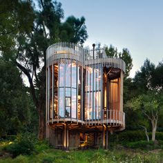 Four cylindrical towers are elevated on stilts to create this retreat in Cape Town, which was designed by local studio Malan Vorster to offer views among the trees.
