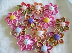 Kanzashi Fabric Flowers PDF Tutorial ... pattern no. 2 ... with free attachment instructions. $6.00, via Etsy.