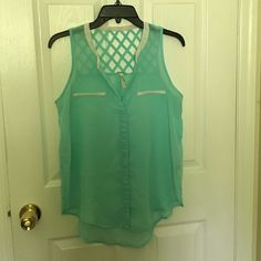Tank Top Teal and White Tank Top. Size Medium. Very thin material. Back has pattern on the top and back is a little longer than the front. 100% polyester. Perfect for a night out in the summer ☀️ Live 4 Truth Tops Tank Tops