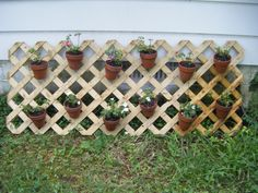 Lattice, metal wire, wire cutters, pliers, terra cotta pots. This took a beating yesterday during the storm, but I wanted to show off my craft project. The hardest part was getting the metal wiring around the pots and secured to the lattice. I'm using purple and white impantiens.