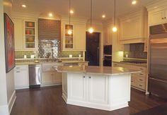 Plaza-condo-remodel-kitchen-island-cabinets-lighting-dark-wood-floor-farmhouse-sink