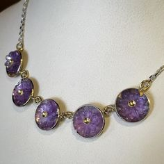 Here is a real summer inspired statement necklace. This Scott & Co. one of a kind features unique flower cut amethysts set in 14k white gold hemispheres with 18k yellow gold rivets. #gemstone #gemstonejewelry #amethyst #twotone #customjewelry #ooak #scottandco #scottandcojewelers