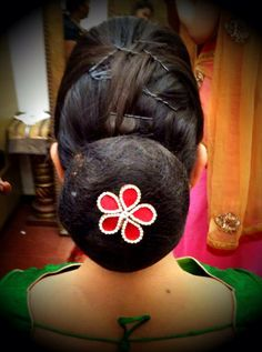 Traditional South Indian bride's bridal hair bun hairstyle. Indian wedding photography. Hairstyle by Swank Studio