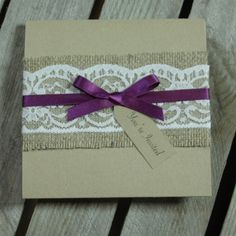 A rustic handmade pocket fold wedding invitation. A design embellished with lovely hessian and lace, finished with double satin ribbon bows. http://www.kathryndeeley.co.uk/the-collection/ashleigh/