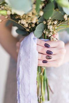 plum and gold glitter manicure