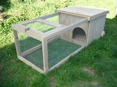 Rabbit Hutch - and it has wheels to move it. Might need to whip one of these up for the guinea pigs this summer.
