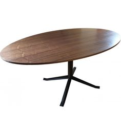 Designer oval table in wood and metal